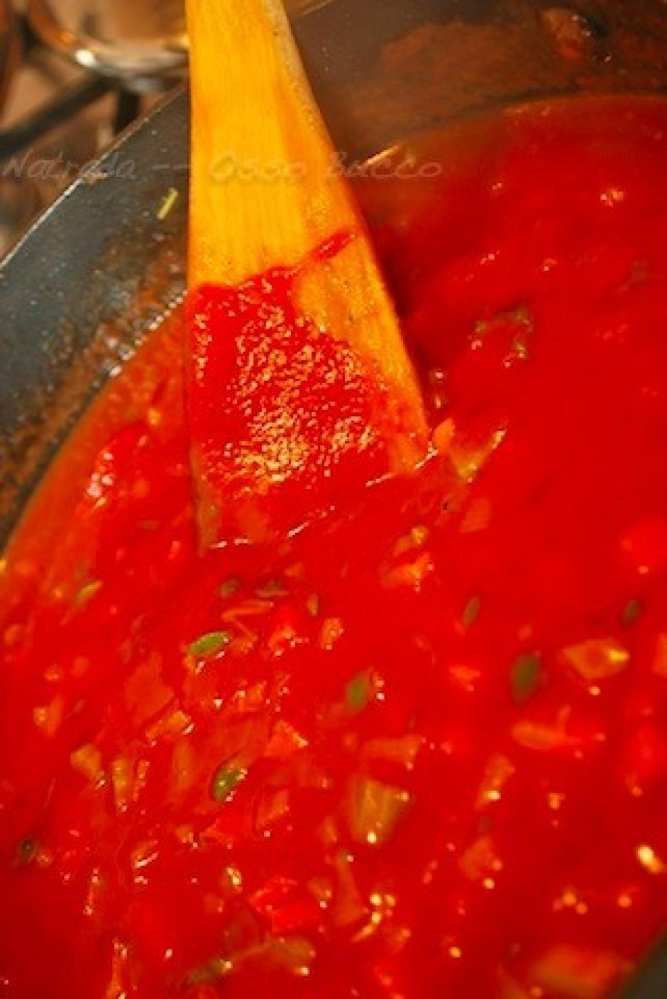 Add crushed tomatoes and veal stock
